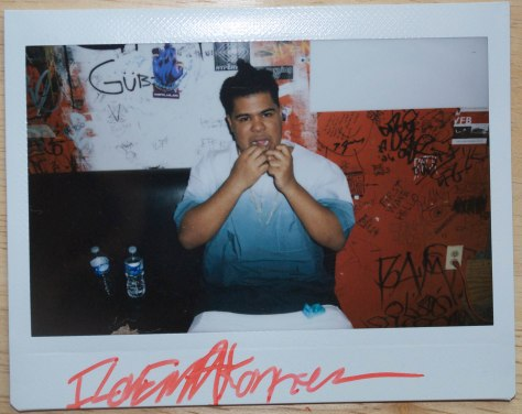 Makonnen flossing before going on stage. By Jesse Wiles.